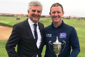 David Hannis, CEO of James Brearley, presents the Lancashire Open trophy to'Steve Parry at Blackpool North Shore