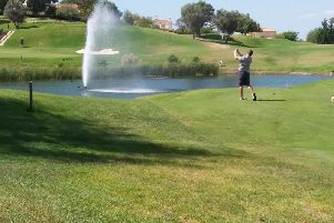 Chris Boyes takes aim over the water at the 17th at Gramacho