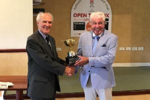 Fylde Senior League president Brian Roult presents the Len Hall Trophy for the season's top individual to Dennis McCullough of Herons Reach (right)