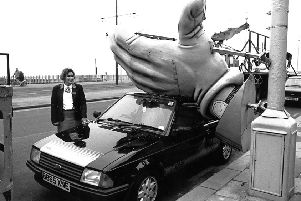 Giant illuminations hand fell on car belonging to Gail Turner , at North Shore, 1990