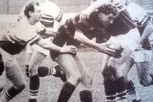 A Moseley player finds himself under intense pressure from West's forwards.