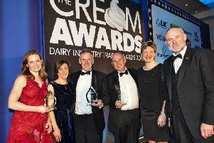 Karen and John Bradley, second and third left, receiving their Cream Award for Derby Hill Dairy's chocolate milk