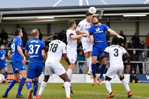 Jordan Tunnicliffe beats Chesterfield's Will Evans to a header: Picture by Steve Flynn/AHPIX.com