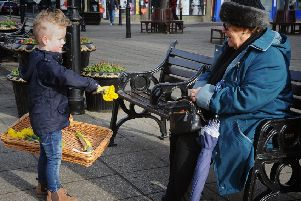 4 year-old Louie Ratcliffe joined his mum Rachael Irvine in handing out free daffodils to locals to mark Valentine's Day.'Louie hands out flowers.  PIC BY ROB LOCK'14-2-2019