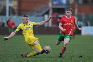 Eddie Cass gets to the ball first ahead of Steve Smith in Hemsworth MW's game against Harrogate Railway Athletic.
