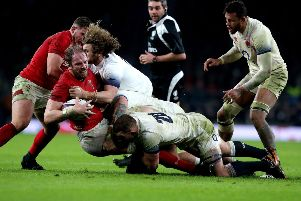 Wales' Alun Wyn Jones (second left) is tackled during the NatWest 6 Nations match at Twickenham Stadium, London. PRESS ASSOCIATION Photo. Picture date: Saturday February 10, 2018. See PA story RUGBYU England. Photo credit should read: Gareth Fuller/PA Wire. RESTRICTIONS: Editorial use only, No commercial use without prior permission.
