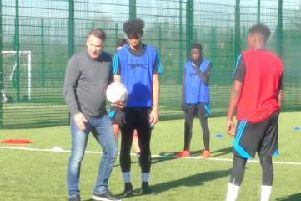 Paul Merson gives a coaching session at Mill Farm