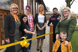 Julie Robinson from Thomas Cook, Karima  (age 9), whose sister attends Derian House, his mum Jo Taleb, Gina Robertson from Thomas Cook, Bolton Wanderers Footballer and Derian Ambassador Jason Lowe, Emma Doherty and her son Bobby Baldwin (age 3)