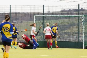 Dani Parker scores one of her three goals against Hull