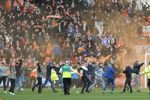 Fans invaded the pitch after Blackpool's stoppage time equaliser