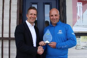 Andrew Richardson of Blackpool North Shore (right) receives his award from Foremost managing director Andy Martin
