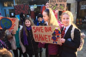 Teens gathered to protest for action on climate change last month.