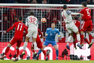 Virgil van Dijk heads home at the Allianz Arena as Liverpool became the fourth English team to win through to the Champions League quarter-finals