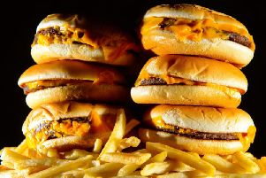 McDonald's has come under fire for its Monopoly promotion, which critics say will encourage unhealthy eating.