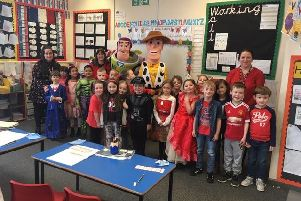 Buzz and Woody with pupils at New Road Primary