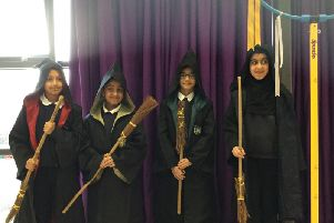 The Reedley students in their cloaks and with their broomsticks.