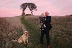 David Wilson is pictured with his grandson Jaxon and his daughter's dog, Bowser. Picture by Oliver's Photography.