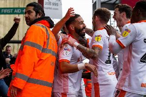 Blackpool's players celebrate with the jubilant fans