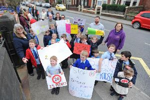 The protest outside Medlar with Wesham Church of England Primary School with the help of parents to urge motorists to slow down.