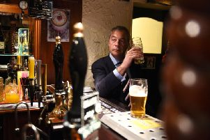 Nigel Farrage, in a pub