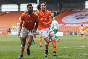 Curtis Tilt celebrates his stoppage-time equaliser for Blackpool with Nya Kirby