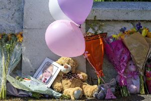 Tributes near a house on Ardbeg Road on the Isle of Bute in Scotland, after the body of Alesha MacPhail was found in woodland on the site of a former hotel by a member of the public.
