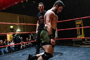 RP Davies, left, at Friday's wrestling event in Hindley, near Wigan