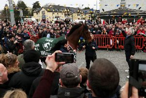 2019 Grand National Winner Tiger Roll with owner Michael O'Leary (right) during the parade through Summerhill, County Meath, Ireland