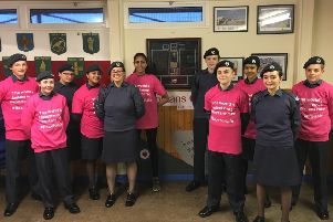 Blackpool Air Cadets in front of their memorial Flight Lieutenant Philip Massey RAFVR(T)'They are urging people to take part in Blackpool Race For Life