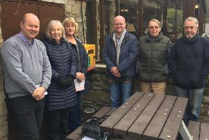 Members of the residents association with the new defibrillator