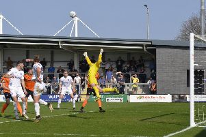 Nick Haughton's cross is punched clear by Barnet keeper Mark Cousins  Picture: STEVE MCLELLAN
