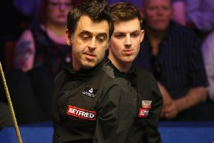 Ronnie O'Sullivan (left) and Blackpool's James Cahill head to head at the Crucible