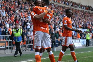 Nathan Delfouneso celebrates his stoppage-time winner