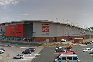 Four men have been charged over an incident at Rotherham United's stadium