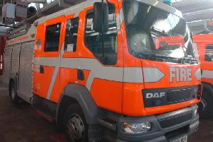 Four fire engines were called out to tackle a washing machine fire at commercial premises in Colne yesterday.