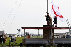 The raising of the flag at Charlie's Mast on Lytham Green