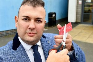 Councillor Stephen Akers-Belcher cuts his Labour membership card in half after resigning from the party. Picture by Frank Reid.