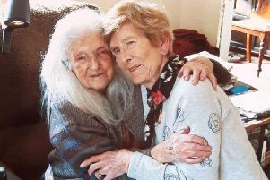 Eileen Macken (right) with her 103-year-old mother Elizabeth who she has met for the first time.