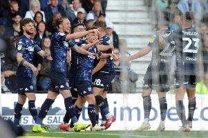 Leeds United players celebrate Kemar Roofe's goal at Derby. Picture: Tony Johnson.