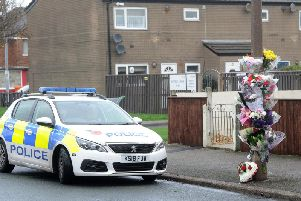 Tributes left at the scene of the crime