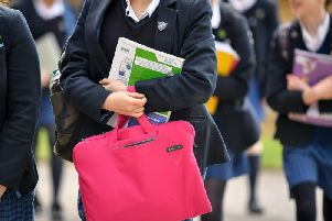 Students carrying bags and books at a school in Bath. The secondary school choice system is unfair to households in areas where they are given fewer options, a study suggests.