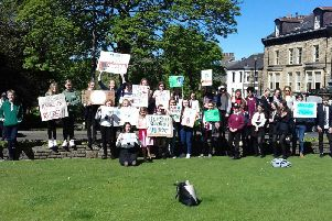 Harrogate youngsters waving banners and shouting loudly on Parliament Street in Harrogate today about climate change.