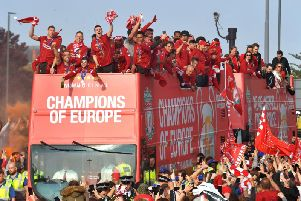 Liverpool players and staff on the bus during the Champions League Winners Parade in Liverpool. PA