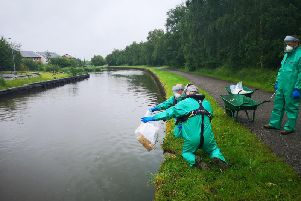 Environmental teams testing the polluted water