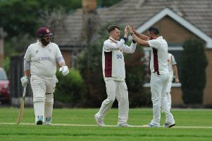 Bilton CC celebrate as Adel batsman Alasdair Fearns trudges off having been dismissed by Tuseif Arshad, right. Picture: Gerard Binks