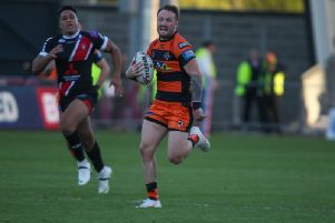 Jordan Rankin bursts clear to score a try for Castleford Tigers at Salford. Picture: Simon Hall