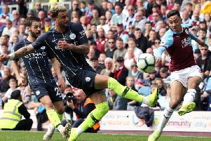 Burnley winger Dwight McNeil in action against Premier League champions Manchester City