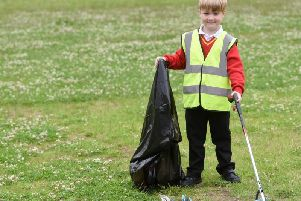 Jenson Pennington picks up litter
