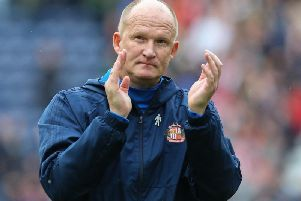 Simon Grayson takes charge of his first game as manager in what is his second stint