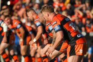 Castleford Tigers line up in defence against Leeds Rhinos. Picture: Simon Hall